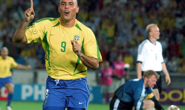 FILE - In this June 30, 2002,  file photo, Brazil's Ronaldo reacts after scoring past Germany's goalkeeper Oliver Kahn, center, and Carsten Ramelow during their 2002 World Cup final soccer match, at the Yokohama stadium in Yokohama, Japan. On this day: Brazil wins its fifth World Cup as Ronaldo strikes twice to defeat Germany 2-0. (AP Photo/Dusan Vranic, File)