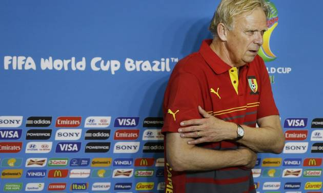 Cameroon coach Volker Finke flinches from the cold air of conditioner during a news conference at the Arena das Dunas in Natal, Brazil, Thursday, June 12, 2014. Cameroon will play in group A in the Brazil 2014 soccer World Cup. (AP Photo/Sergei Grits)