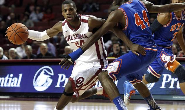 Oklahoma's Buddy Hield (24) looks to get around Texas-Arlington's Anthony Walker (44) during the men's college basketball game between the University of Oklahoma and UT-Arlington, at the LLoyd Noble Center in Norman, Okla. Tuesday, Dec. 17, 2013. Photo by Sarah Phipps, The Oklahoman