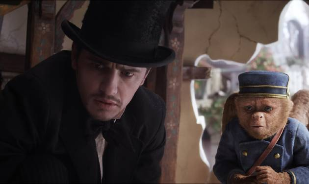 """FILE - This file film image provided by Disney Enterprises shows James Franco, as Oz, left, and the character Finley, voiced by Zach Braff, in a scene from """"Oz the Great and Powerful."""" """"Oz the Great and Powerful"""" is living up to its name at the box office. Walt Disney's 3-D blockbuster has led all films for the second week in a row, taking in $42.2 million according to studio estimates Sunday, March 17, 2013. Sam Raimi's prequel to the L. Frank Baum classic """"The Wonderful Wizard of Oz"""" also took in $46.6 million overseas, leading to two-week worldwide total of $281.8 million. (AP Photo/Disney Enterprises, File)"""