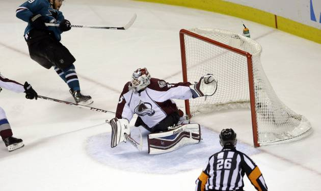 San Jose Sharks' Martin Havlat, top left, of the Czech Republic, scores his second goal of the game past Colorado Avalanche goalie Jean-Sebastien Giguere, during the third period of an NHL hockey game Friday, April 11, 2014, in San Jose, Calif. San Jose won 5-1. (AP Photo/Marcio Jose Sanchez)