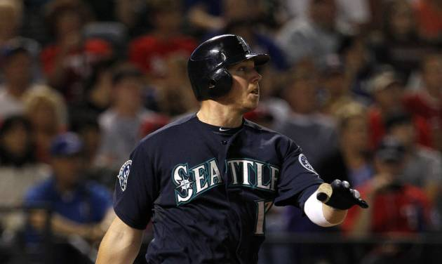 Seattle Mariners' Justin Smoak follows through on a single off of Texas Rangers' Scott Feldman, scoring Michael Saunders, in the third inning of a baseball game Saturday, Sept. 15, 2012, in Arlington, Texas. (AP Photo/Tony Gutierrez)