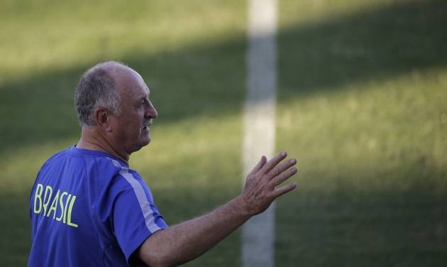 Brazil's coach Luiz Felipe Scolari gestures as he arrives for a training session in Fortaleza, Brazil, Thursday, July 3, 2014. Brazil will face Colombia on Friday in a quarterfinal soccer match at the World Cup. (AP Photo/Felipe Dana)