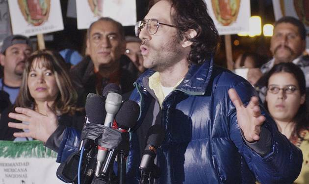 FILE - In this Dec. 11, 2003 file photo, Dov Charney, senior partner of American Apparel, announces he will shutter his garment manufacturing plant that employs some 1,500 workers, in observance of a scheduled Dec. 12 economic strike by Latinos, at a rally at Los Angeles' downtown Plaza. As of Friday, June 27, 2014, the ousted CEO has increased his stake in the clothing chain to nearly 43 percent as he fights to keep control of the company he founded. Previously, his stake was 27 percent. (AP Photo/Reed Saxon, File)