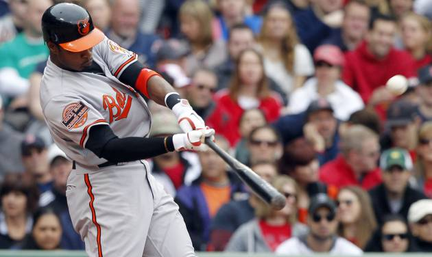 Baltimore Orioles' Adam Jones hits a two-run home run during the third inning of a baseball game against the Boston Red Sox in Boston, Saturday, May 5, 2012. (AP Photo/Michael Dwyer)