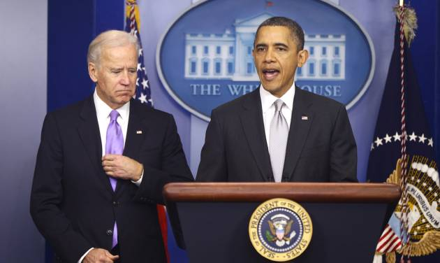 President Barack Obama stands with Vice President Joe Biden as he makes a statement in the Brady Press Briefing Room about policies he will pursue following the Newtown, Ct., school shootings, Wednesday, Dec. 19, 2012, at the White House in Washington. (AP Photo/Charles Dharapak)