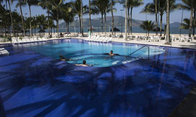 FILE - In this May 8, 2014 file photo, guests wade in the pool at Hotel Portobello where Italy's soccer team will train and reside during the World Cup in Mangaratiba, Brazil. A Brazilian consumer defense agency said Monday, May 26, 2014 it's found past-expiration food at Hotel Portobello as well as the Royal Tulip Hotel where England's team will stay during the World Cup. The Rio de Janeiro state agency said that the inspections were part of an effort to enforce food safety codes ahead of next month's tournament. (AP Photo/Hassan Ammar, File)