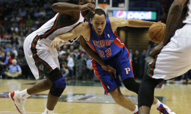 Detroit Pistons forward Tayshaun Prince (22) attempts to get around Milwaukee Bucks forward Luc Richard Mbah a Moute during the first half of an NBA basketball game Friday, Jan. 11, 2013, in Milwaukee. (AP Photo/Morry Gash)