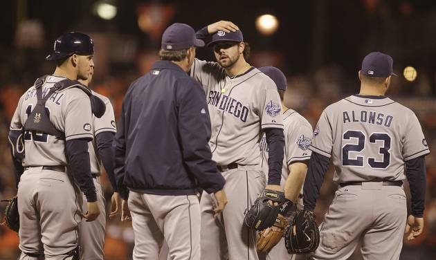 San Diego Padres' Casey Kelly places his hand to his cap as he meets with pitching coach Darren Balsley in the fifth inning of a baseball game against the against the San Francisco Giants Friday, Sept 21, 2012, in San Francisco. (AP Photo/Ben Margot)