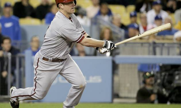 Arizona Diamondbacks' Aaron Hill watches his two-RBI single against the Los Angeles Dodgers during 12th inning of a baseball game in Los Angeles, Friday, April 18, 2014. (AP Photo/Chris Carlson)
