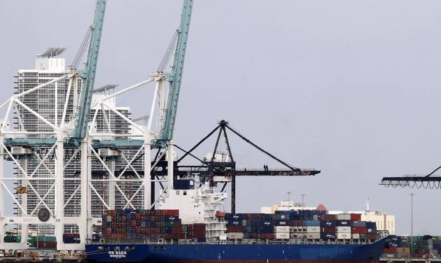 In this Tuesday, Nov. 13, 2012 photo, the container ship HS Bach is shown docked at the Port of Miami. The U.S. trade deficit expanded in November to its widest point in seven months, driven by a surge in imports that outpaced modest growth in exports. (AP Photo/Wilfredo Lee)