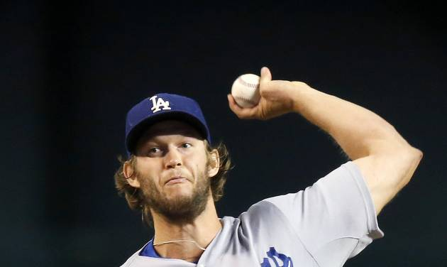 Los Angeles Dodgers' Clayton Kershaw throws a pitch against the Arizona Diamondbacks during the first inning of a baseball game Wednesday, Aug. 27, 2014, in Phoenix. (AP Photo/Ross D. Franklin)