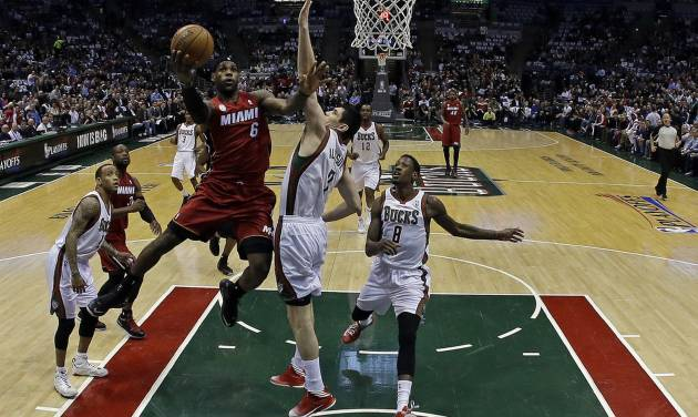 Miami Heat's LeBron James (6) shoots during the first half of Game 3 in their first-round NBA basketball playoff series against the Milwaukee Bucks, Thursday, April 25, 2013, in Milwaukee. The Heat won 104-91 to take a 3-0 lead in the series. (AP Photo/Morry Gash)