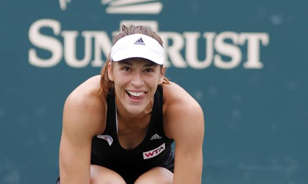 Andrea Petkovic, of Germany, reacts after defeating Jana Cepelova, of Slovakia, in two sets during the Family Circle Cup tennis tournament final in Charleston, S.C., Sunday, April 6, 2014. Petkovic won 7-5, 6-2 to win the championship. (AP Photo/Mic Smith)