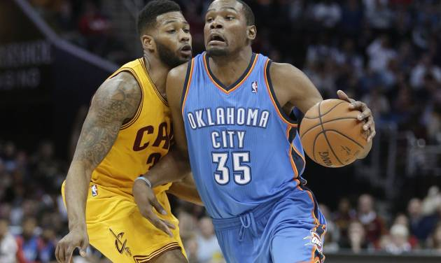 Oklahoma City Thunder's Kevin Durant (35) is fouled by Cleveland Cavaliers' Alonzo Gee (33) during the third quarter of an NBA basketball game Thursday, March 20, 2014, in Cleveland. Oklahoma City defeated Cleveland 102-95. (AP Photo/Tony Dejak)