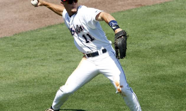 Mississippi's Braxton Lee throws the ball to third during the eighth inning against Arkansas, during the Southeastern Conference NCAA college baseball tournament Wednesday, May 21, 2014, in Hoover, Ala. (AP Photo/Butch Dill)