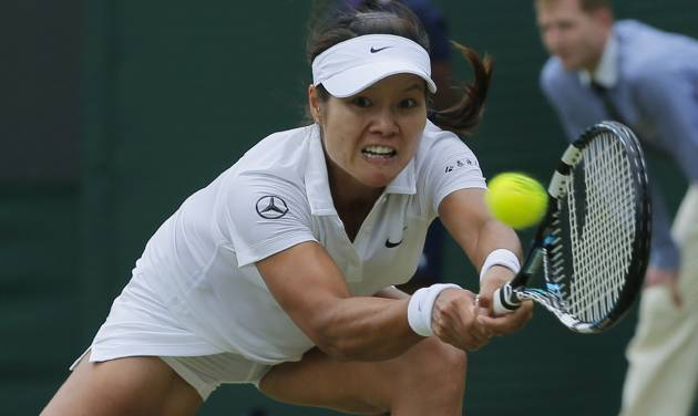 Li Na of China plays a return to Barbora Zahlavova Strycova of the Czech Republic during their women's singles match at the All England Lawn Tennis Championships in Wimbledon, London, Friday  June  27, 2014. (AP Photo/Pavel Golovkin)