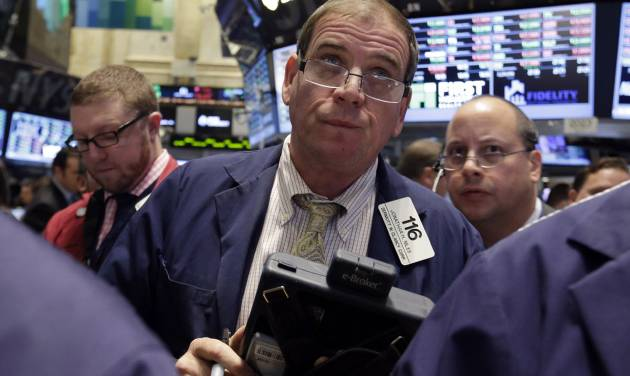 Trader Jonathan Niles, center, works on the floor of the New York Stock Exchange, Friday, Oct. 25, 2013. Earnings gains from Microsoft and other big U.S. companies are pushing the stock market higher in early trading. (AP Photo/Richard Drew)