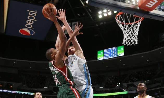 Milwaukee Bucks forward Giannis Antetokounmpo, front left, of Greece, goes up to shoot as Denver Nuggets center Timofey Mozgov, of Russia, front right, covers in the first quarter of an NBA basketball game in Denver, Wednesday, Feb. 5, 2014. Nuggets guard Evan Fournier, back left, of France, and forward Darrell Arthur look on. (AP Photo/David Zalubowski)