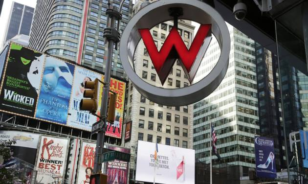 FILE  - In this Wednesday, July 31, 2013, file photo, a W Hotel is located in Times Square, in New York.  The luxury hotel is owned by Starwood Hotels & Resorts Worldwide, who reports earnings on Thursday, Feb. 13, 2014. (AP Photo/Mark Lennihan)
