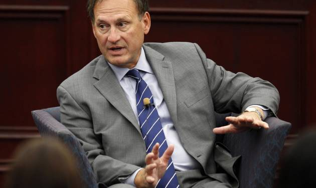FILE - In this Sept. 14, 2012 file photo, Supreme Court Associate Justice Samuel Alito speaks at Roger Williams University Law School in Bristol, R.I. Alito is defending the court's 2010 decision in the Citizens United case that helped fuel hundreds of millions of dollars of spending by independent groups in the just-concluded campaign season. (AP Photo/Stephan Savoia, File)