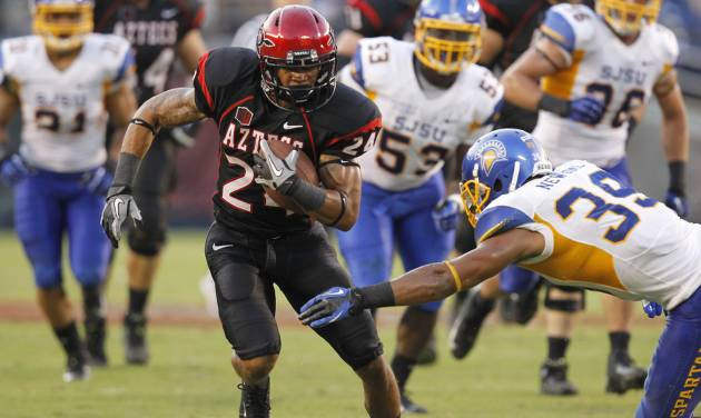 San Diego State wide receiver Colin Lockett, front left, tries for extra yardage during an NCAA college football game against San Jose State, Saturday , Sept. 22, 2012, in San Diego. (AP Photo/UT San Diego, Earnie Grafton) SAN DIEGO COUNTY OUT; NO SALES; COMMERCIAL INTERNET OUT; FOREIGN OUT