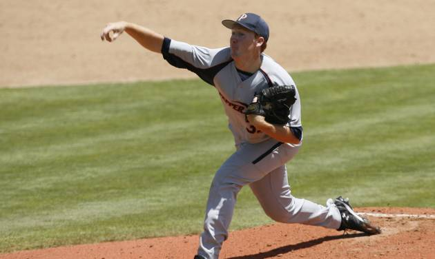 Pepperdine pitcher Corey Miller throws during the first inning against Arizona State in an NCAA college baseball tournament regional game Friday, May 30, 2014, in San Luis Obispo, Calif. (AP Photo/Aaron Lambert)