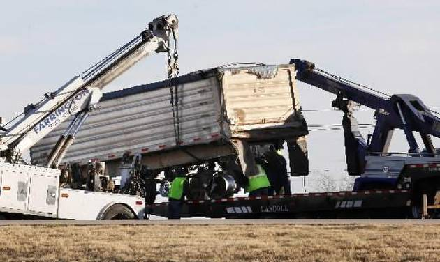 Large wreckers try to lift a semi trailer involved in an accident in the northbound lanes on the John Kilpatrick Turnpike just north of the NW Expressway in Oklahoma City Tuesday, Dec. 4, 2012. Photo by Paul B. Southerland