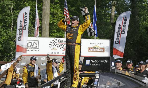 Brendan Gaughan celebrates after winning the NASCAR Nationwide series auto race at Road America in Elkhart Lake, Wi., Saturday, June, 21, 2014.  (AP Photo/Jeffrey Phelps)
