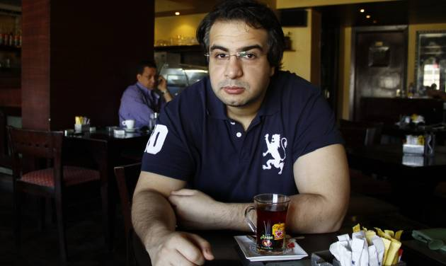 This June 29, 2012 photo shows Egyptian blogger Bassem Sabry during a newspaper interview in Cairo, Egypt. Sabry, one of Egypt's most respected bloggers and a democracy advocate who chronicled the country's turmoil since the 2011 uprising that ousted autocrat Hosni Mubarak, has died. He was 31. (AP Photo/Mohamed Nouhan, El Shorouk newspaper) EGYPT OUT