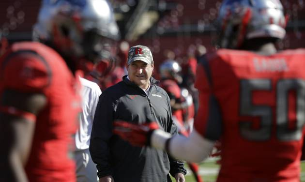 Rutgers defensive coordinator Dave Cohen watches his players warm-up before an NCAA college football game against Cincinnati in Piscataway, N.J., Saturday, Nov. 16, 2013. (AP Photo/Mel Evans)