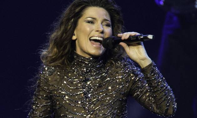 FILE - This Dec. 1, 2012 file photo shows Shania Twain performing at The Colosseum at Caesars Palace in Las Vegas. Twain says she'll end her residency in Las Vegas with a final show Dec. 13, 2014, two years after she began performing at Caesars Palace. (Photo by Eric Jamison/Invision/AP, File)