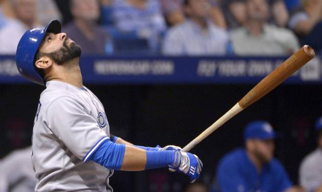 Toronto Blue Jays' Jose Bautista watches the flight of the ball after hitting a pop up for an out during the fifth inning of a baseball game against the Tampa Bay Rays in St. Petersburg, Fla., Thursday, April 3, 2014. (AP Photo/Phelan M. Ebenhack)