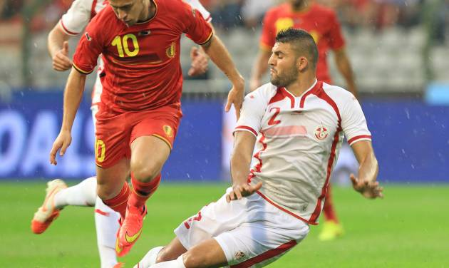 Tunisia's Syam Ben Youssef, right, tries to tackle Belgium's Eden Hazard, during a friendly soccer match at the King Baudouin stadium in Brussels, Saturday, June 7, 2014. Belgium will play against South Korea, Russia and Algeria in Group H of the World Cup 2014 in Brazil. (AP Photo/Yves Logghe)