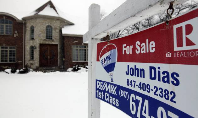 """In this Wednesday, Feb. 27, 2013, photo, a """"for sale"""" sign is seen outside a home in Glenview, Ill., Average U.S. rates on fixed mortgages moved closer to historic lows this week, a trend that has helped drive a rebound in home sales.  (AP Photo/Nam Y. Huh)"""