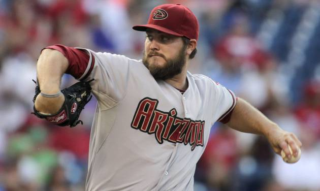 Arizona Diamondbacks starting pitcher Wade Miley throws against the Philadelphia Phillies in the first inning of a baseball game on Friday, July 25, 2014, in Philadelphia. (AP Photo/H. Rumph Jr)
