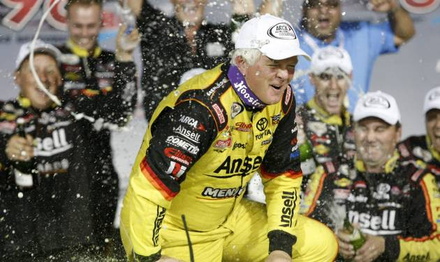 Frank Kimmel is sprayed by his crew after winning an ARCA racing series auto race and the ARCA points championship at Kansas Speedway in Kansas City, Kan., Friday, Oct. 4, 2013. (AP Photo/Colin E. Braley)