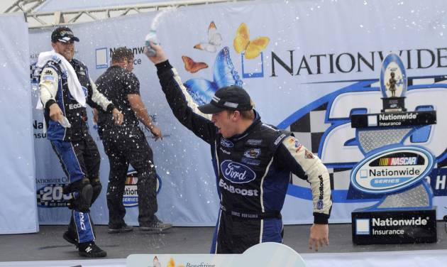 Chris Buescher celebrates after winning the NASCAR Nationwide Series Nationwide Children's Hospital 200 auto race at Mid-Ohio Sports Car Course, Saturday, Aug. 16, 2014, in Lexington, Ohio. (AP Photo/Tom E. Puskar)
