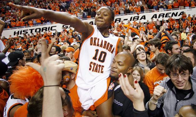 OSU's Andrea Riley (10) celebrates with fans after the women's Bedlam college basketball game between the Oklahoma State Cowgirls and the Oklahoma Sooners at Gallagher-Iba in Stillwater, Okla., Saturday, January 12, 2008. OSU won, 82-63. BY NATE BILLINGS, THE OKLAHOMAN