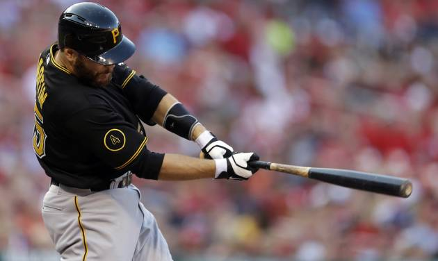 Pittsburgh Pirates' Russell Martin follows through on an RBI single during the first inning of a baseball game against the St. Louis Cardinals Thursday, July 10, 2014, in St. Louis. (AP Photo/Jeff Roberson)