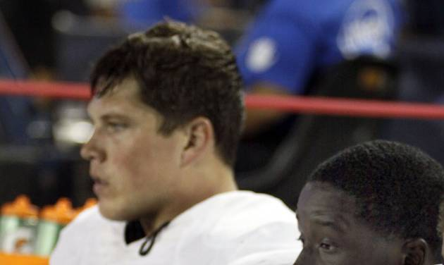 Oklahoma State defensive ends Ryan Robinson (96) and Cooper Bassett (80) can only watch as Arizona's offensive scores another touchdown during the second half of an NCAA college football game at Arizona Stadium in Tucson, Ariz., Sat., Sept. 8, 2012. (AP Photo/Wily Low)