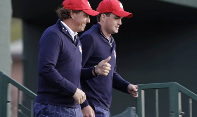 USA's Keegan Bradley, right, and Phil Mickelson make their way to the first tee for a foursomes match at the Ryder Cup PGA golf tournament Friday, Sept. 28, 2012, at the Medinah Country Club in Medinah, Ill. (AP Photo/Chris Carlson)