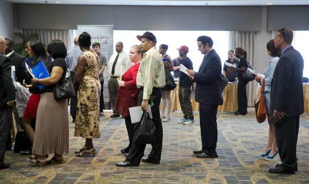 In this June 23, 2014 photo, people wait in line to meet with recruiters during a job fair in Philadelphia. The Labor Department reports on the number of people who applied for unemployment benefits last week on Thursday, Aug. 21, 2014. (AP Photo/Matt Rourke)