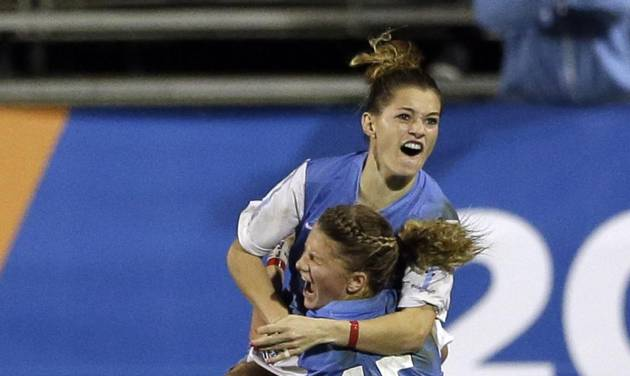 North Carolina's Kealia Ohai, above, celebrates her goal in overtime with teammate Katie Bowen (15) after beating Stanford in an NCAA women's college soccer semifinal game Friday, Nov. 30, 2012, in San Diego. North Carolina won, 1-0. (AP Photo/Gregory Bull)