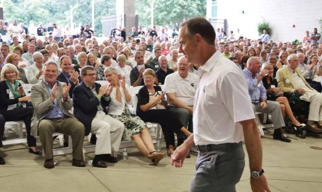 In this Monday, Aug. 25, 2014, photo, Michigan State NCAA college head football coach Mark Dantonio walks away after speaking to guests touring the the new North End Zone Complex renovations at Spartan Stadium on the Michigan State Campus in East Lansing, Mich. (AP Photo/Detroit Free Press, Ryan Garza)  DETROIT NEWS OUT, TV OUT, INTERNET OUT, MAGS OUT, NO SALES, MANDATORY CREDIT DETROIT FREE PRESS