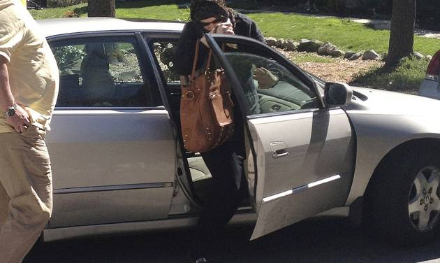 In this Sunday, April 21, 2013 photo, Katherine Russell Tsarnaev, center, wife of killed Boston Marathon bombing suspect Tamerlan Tsarnaev, exits a car at the home of her parents in North Kingstown, R.I.  At left is her father, Warren Russell.  (AP Photo/Katie Zezima)