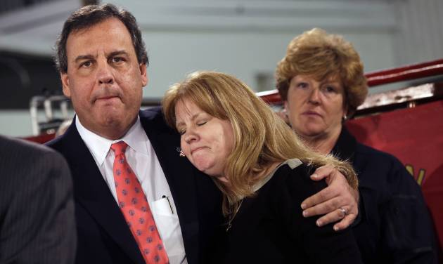 New Jersey Gov. Chris Christie hugs Amy Peters, of Manahawkin, Thursday, Jan. 16, 2014, in Manahawkin, N.J., as he meets with homeowners who lost their homes last year to Superstorm Sandy. Christie spoke to Superstorm Sandy victims one week after the meeting was hastily canceled because of a scandal over traffic jams that appear to have been manufactured by his aides. Christie and Community Affairs Commissioner Richard Constable III announced a Sandy housing recovery milestone Thursday as the governor seeks to put the traffic scandal behind him. (AP Photo/Mel Evans)