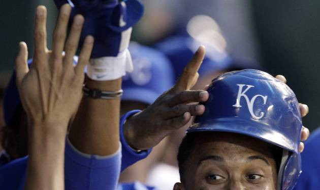 Kansas City Royals' Alcides Escobar celebrates in the dugout after hitting a two-run home run during the third inning of a baseball game against the Detroit Tigers Wednesday, April 18, 2012, in Kansas City, Mo. (AP Photo/Charlie Riedel)