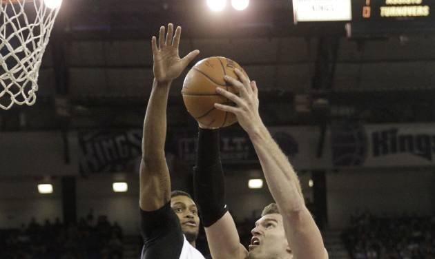 San Antonio Spurs center Tiago Splitter, right, of Brazil, drives to the basket against Sacramento Kings forward Rudy Gay during the first quarter of an NBA basketball game in Sacramento, Calif., Friday, March 21, 2014.(AP Photo/Rich Pedroncelli)
