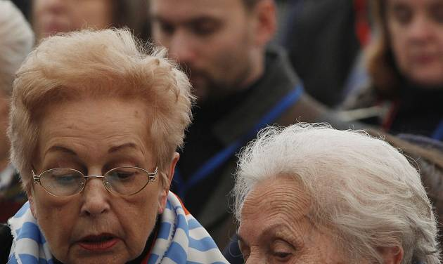 Former prisoners  of the Auschwitz concentration camp attend  a ceremony  in Oswiecim, Poland, Sunday, Jan. 27, 2013, marking the 68th anniversary of the liberation of Auschwitz by Soviet troops and  remembering the victims of the Holocaust, in Auschwitz-Birkenau.  (AP Photo/Czarek Sokolowski)